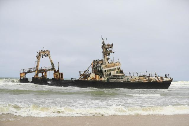 <p>On the way north, I passed the Zeila, a fishing trawler stranded on a sand bar since 2008, about 15 kilometers south of Henties Bay. This vessel, just offshore, was covered with cormorants, which have made it their home. (Photo: Gordon Donovan/Yahoo News) </p>