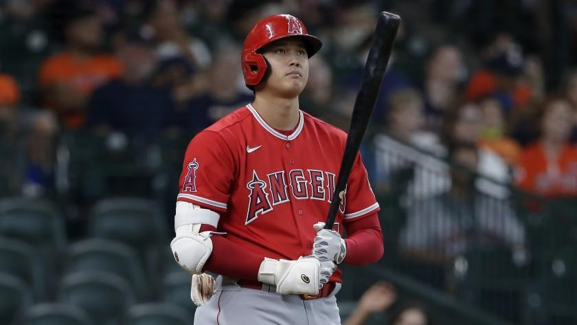 Los Angeles Angels designated hitter Shohei Ohtani approaches the plate to bat.