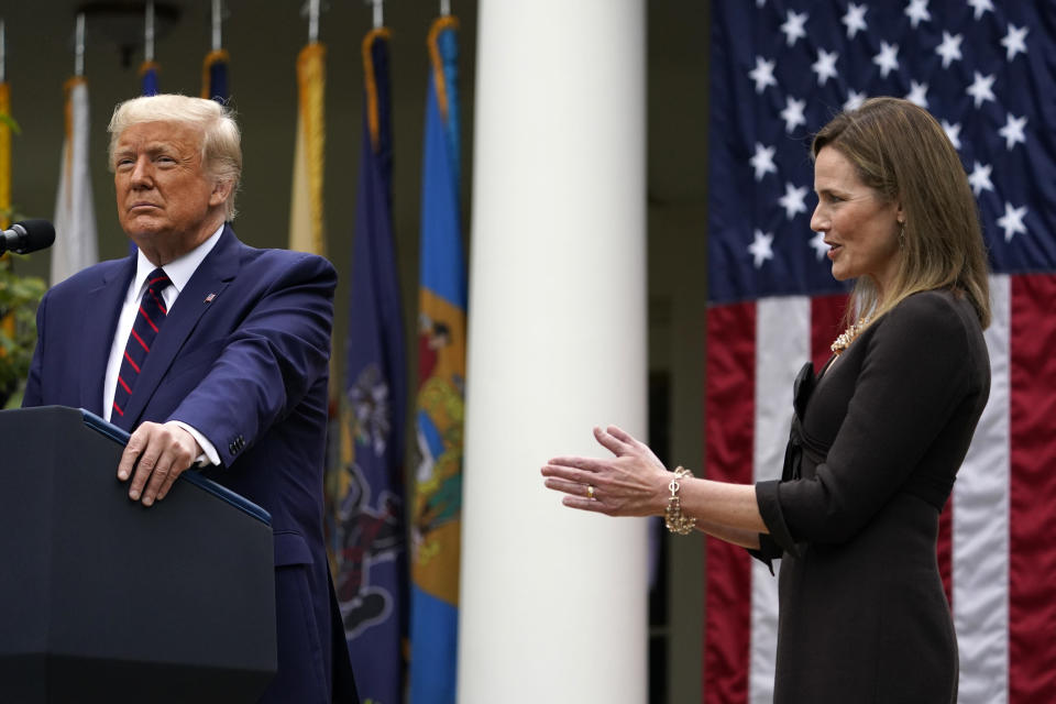 Judge Amy Coney Barrett applauds as President Donald Trump announces Barrett as his nominee to the Supreme Court, in the Rose Garden at the White House, Saturday, Sept. 26, 2020, in Washington. (AP Photo/Alex Brandon)