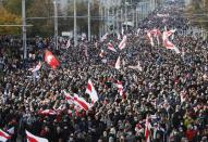 Belarusian opposition supporters hold a rally in Minsk