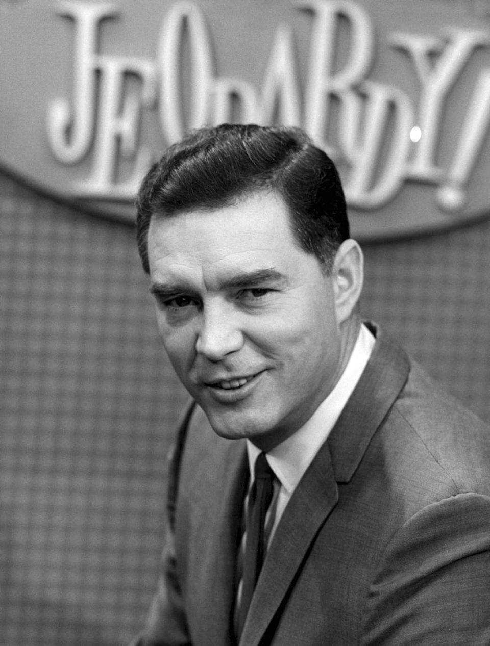 <p>Few people remember a time for <em>Jeopardy! </em>without Alex Trebek, but the show actually dates back to 1964 with a different host. Art Fleming originally led the quiz show until 1975, and then again from 1978–1979. Originally an actor, Fleming was discovered by Merv Griffin for his role in a commercial. Fleming continued to act <em>Jeopardy! </em>was originally canceled, and then refused to return for the 1983 revival. Fleming died from pancreatic cancer in 1995.</p>