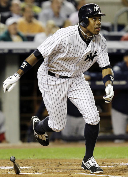 New York Yankees' Curtis Granderson watches his second-inning, two-run home run off Boston Red Sox starting pitcher Clay Buchholz during their baseball game at Yankee Stadium in New York, Monday, Oct. 1, 2012. (AP Photo/Kathy Willens)