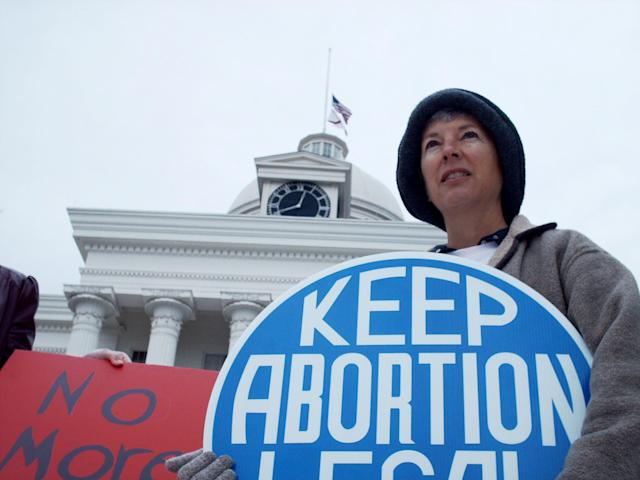 Amy Applegate holds a sign during a rally by the Montgomery chapter of the National Organization for Women as they gather on the steps of the State Capitol in Montgomery, Ala., Monday, Jan. 22, 2007, to celebrate the Roe v. Wade decision in 1973 that legalized abortion. (AP Photo/Desiree Hunter)
