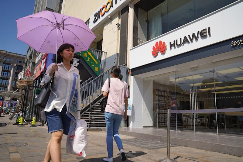 BEIJING,CHINA – JULY 1: People walk past a Huawei store on July 1, 2019 in Dongdaqiao, Chaoyang District, Beijing. (Photo by Andrea Verdelli/Getty Images)