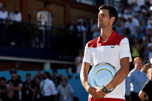 Tennis - ATP 500 - Fever-Tree Championships - The Queen's Club, London, Britain - June 24, 2018 Serbia's Novak Djokovic with the runners up trophy after losing the final against Croatia's Marin Cilic Action Images via Reuters/Tony O'Brien