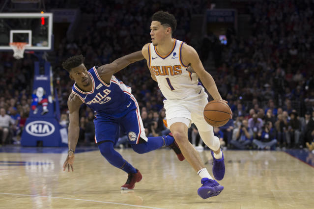 """<a class=""""link rapid-noclick-resp"""" href=""""/nba/players/5473/"""" data-ylk=""""slk:Devin Booker"""">Devin Booker</a> dribbles by <a class=""""link rapid-noclick-resp"""" href=""""/nba/players/4912/"""" data-ylk=""""slk:Jimmy Butler"""">Jimmy Butler</a> in a recent game against the 76ers. (Getty)"""