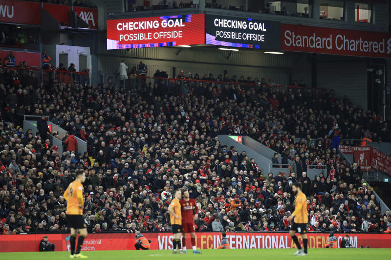 The video screens announce that a Wolverhampton Wanderers' goal is being checked, before it was disallowed for offside, during the English Premier League soccer match between Liverpool and Wolverhampton Wanderers at Anfield Stadium, Liverpool, England, Sunday Dec. 29, 2019. (AP Photo/Jon Super)