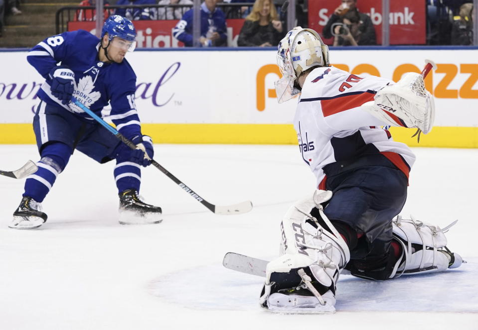 Toronto Maple Leafs left wing Andreas Johnsson (18) takes a shot on Washington Capitals goaltender Braden Holtby (70) during the second period of an NHL hockey game Tuesday, Oct. 29, 2019, in Toronto. (Hans Deryk/The Canadian Press via AP)