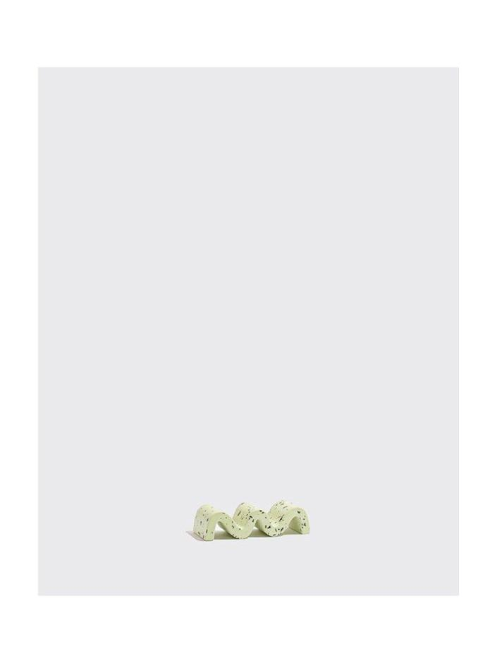 """$62, Yowie. <a href=""""https://www.shopyowie.com/collections/newness/products/pistachio-squiggle-paperweight"""" rel=""""nofollow noopener"""" target=""""_blank"""" data-ylk=""""slk:Get it now!"""" class=""""link rapid-noclick-resp"""">Get it now!</a>"""