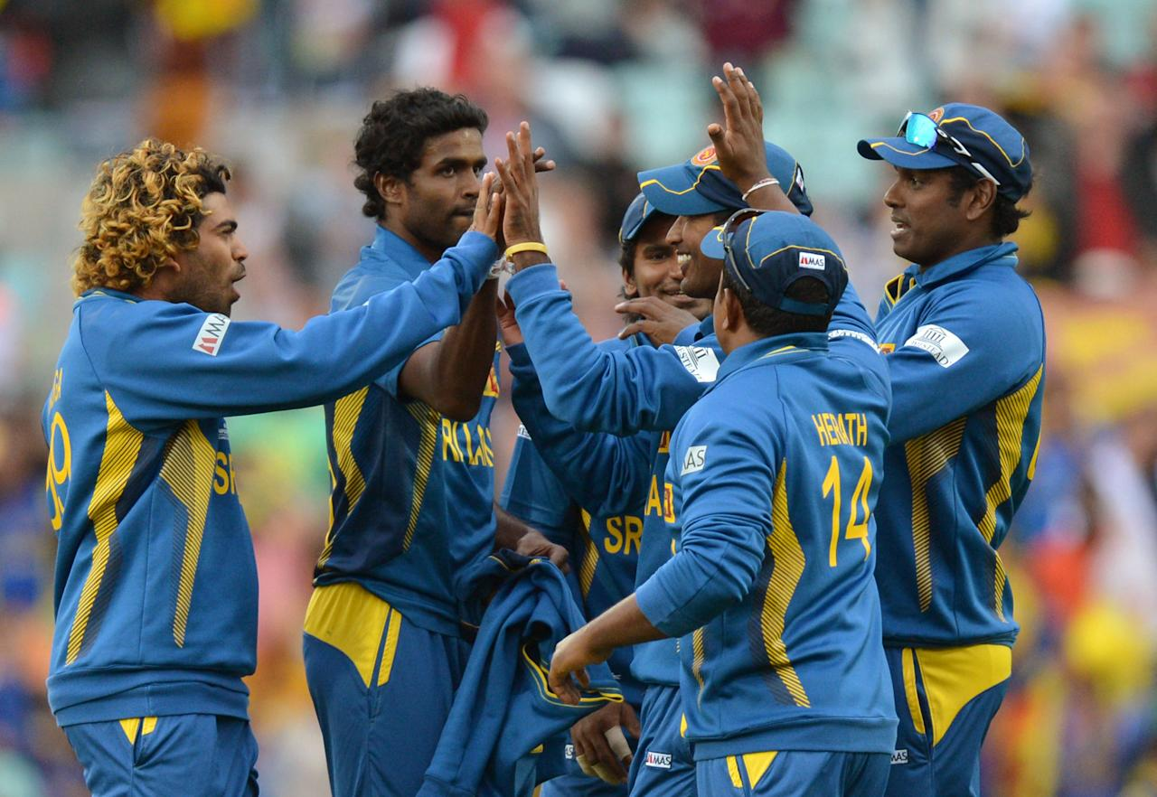 Sri Lanka celebrate taking the wicket of Australia's Mitchell Johnson (not pictured) during the ICC Champions Trophy match at The Oval, London.