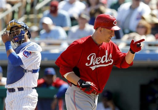 Cincinnati Reds' Todd Frazier celebrates his home run during the second inning of a spring training baseball game in Mesa, Ariz., Monday, March 12, 2012. Chicago Cubs catcher Geovany Soto is at left. (AP Photo/Chris Carlson)