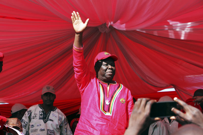 Movement For Democratic Change (MDC) President Morgan Tsvangirai greets the crowd at the launch of the party's election campaign in Marondera, east of Harare, Sunday, July, 7, 2013. Tsvangirai kicked off his election campaign which will see him contest against President Robert Mugabe in an election set for July 31 2013. (AP Photo/Tsvangirayi Mukwazhi)