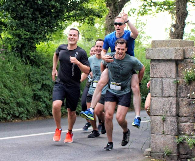 <p>Superman always saves the day! Cavill broke a sweat while serving as ambassador for the Durrell Challenge 2017, a run to raise money for the Durrell Wildlife Conservation Trust in his native Jersey, England. (Photo: Mirrorpix/Splash News) </p>