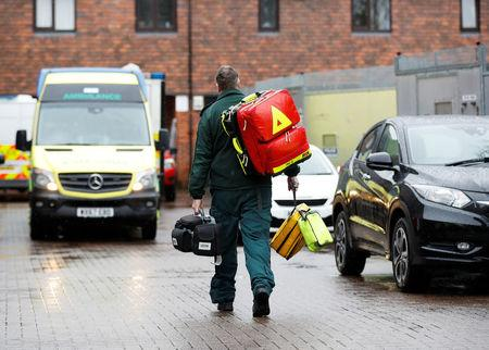 A parademic carries equipment near to where former Russian intelligence officer Sergei Skripal and his daughter Yulia were found poisoned in Salisbury
