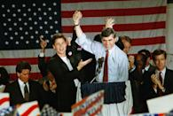 Democratic presidential candidate Michael Dukakis raises his hand in a victory salute with actor Rob Lowe for an enthusiastic crowd that greeted the Massachusetts governor at the Amtrack station in Stockton, Calif., on Sunday, Oct. 31, 1988, the last stop of his six-city whistle stop campaign through California?s central valley. (AP Photo/Rich Pedroncelli)