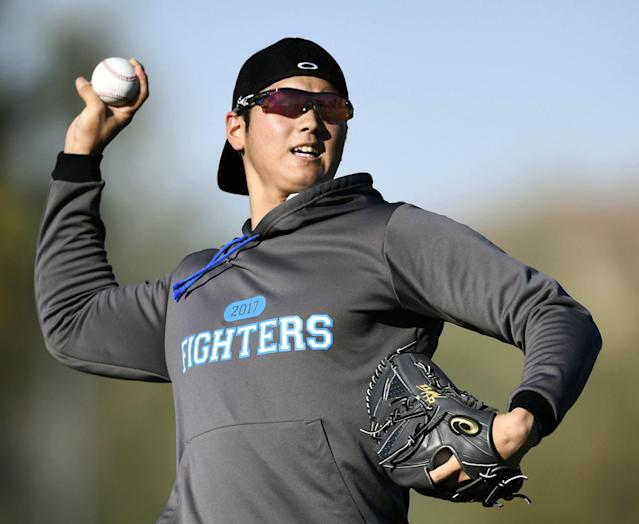 Shohei Otani pitches during the Nippon Ham Fighters' spring camp in January. (Junko Ozaki/Kyodo News via AP)