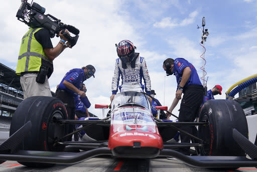 James Davison, of Australia, climbs into his car during a practice session for the Indianapolis 500 auto race at Indianapolis Motor Speedway, Friday, Aug. 14, 2020, in Indianapolis. (AP Photo/Darron Cummings)