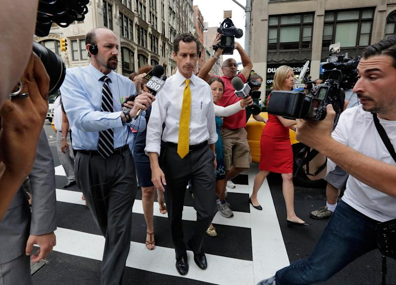 New York City mayoral candidate Anthony Weiner is pursued by reporters after leaving his apartment in New York on Wednesday, July 24, 2013. The former congressman acknowledged sending explicit text messages to a woman as recently as last summer, more than a year after sexting revelations destroyed his congressional career. (AP Photo/Richard Drew)