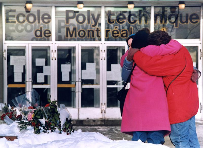 Three women hug each other after laying flowers in front of the Polytechnical School at the University of Montreal on Dec. 9, 1989. (Photo: Shaney Komulainen / The Canadian Press)
