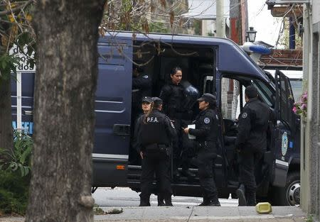 Police stand near the home of Juan Alberto Cabral, father of Juventus' soccer player Tevez, in Buenos Aires