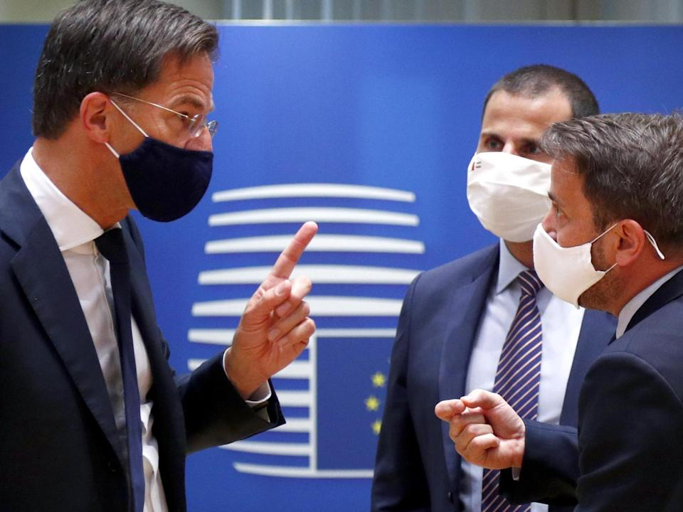 Dutch prime minister Mark Rutte (L) and Luxembourg's premier Xavier Bettel exchange words on Saturday: EPA