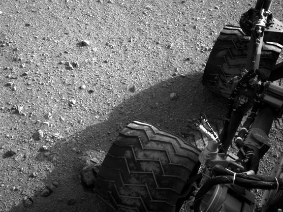 Martian dirt clings to the wheels of NASA's Curiosity rover in this photo taken Aug. 28, 2012, after the rover's first long drive, a 52-foot trek.