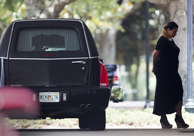 <p>A mourner stands outside the funeral service for Kimberly Morris, one of the victims of the Pulse nightclub mass shooting, in Kissimmee, Fla. (Photo: David Goldman/AP) </p>