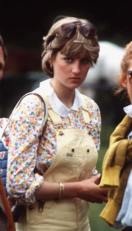 <p>Here, Princess Diana watches Prince Charles play polo ahead of their engagement. Dressed in lemon dungarees and a floral shirt, Diana accompanied the look with a relaxed eighties-style bouffant. <em>[Photo: Getty]</em> </p>