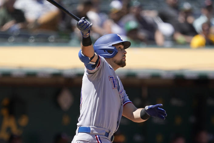 Texas Rangers' Nate Lowe watches his two-run home run during the seventh inning of a baseball game against the Oakland Athletics in Oakland, Calif., Thursday, July 1, 2021. (AP Photo/Jeff Chiu)