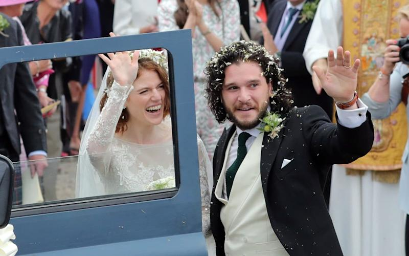 Game of Thrones stars Kit Harington and Rose Leslie climb into a Land Rover Discovery to make their way to their reception - GC Images