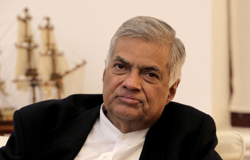 FILE -In this Friday, Nov. 2, 2018, file photo, ousted Sri Lankan Prime Minister Ranil Wickremesinghe listens during an interview with the Associated Press at his official residence in Colombo, Sri Lanka. (AP Photo/Eranga Jayawardena, File)