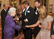 <p>Elle Macpherson looked modest next to Queen Elizabeth's bright purple ensemble during an event at Buckingham Palace in 2011. The Australian supermodel wore a monochrome outfit, pairing a beige dress with a nude handbag. </p>