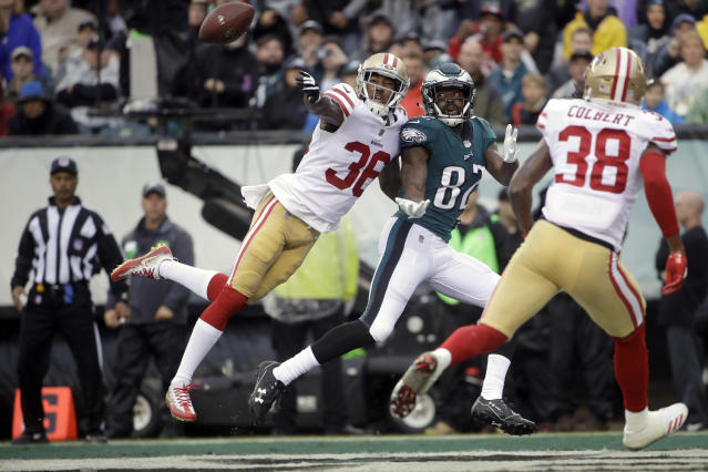 <p>San Francisco 49ers' Adrian Colbert (38) and Philadelphia Eagles' Torrey Smith (82) reach for a pass during the first half of an NFL football game, Sunday, Oct. 29, 2017, in Philadelphia,. (AP Photo/Michael Perez) </p>