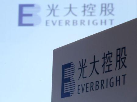 FILE PHOTO: The company logos of China Everbright International are displayed at a news conference on the company's annual results in Hong Kong, China March 23, 2016.      REUTERS/Bobby Yip/File Photo