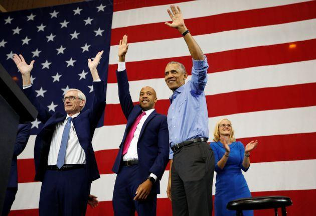 Former President Barack Obama campaigns for Democrats Tony Evers (left) for governor, Mandela Barnes for lieutenant governor and Sarah Godlewski for state treasurer at a school in Milwaukee on Oct. 26, 2018. All three were successful. (Photo: Sara Stathas/Reuters)