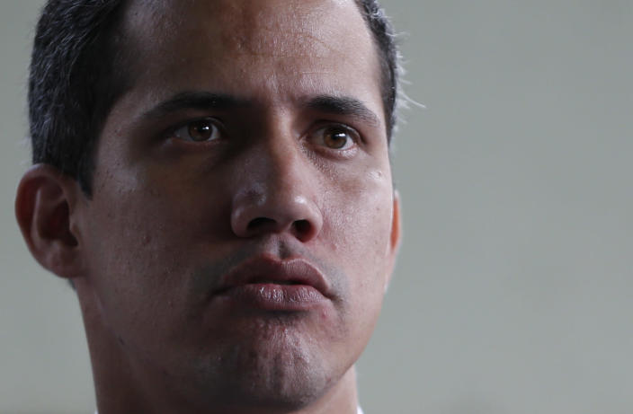 """Opposition leader Juan Guaido, who has declared himself interim president of the country, attends a press conference at a school where he delivered humanitarian aid, in Caracas, Venezuela, Thursday, March 21, 2019. Guaido says the Venezuelan government is weak and doesn't """"dare"""" to detain him. Guaido spoke Thursday after intelligence agents staged an overnight raid and detained Roberto Marrero, his key aide. (AP Photo/Natacha Pisarenko)"""