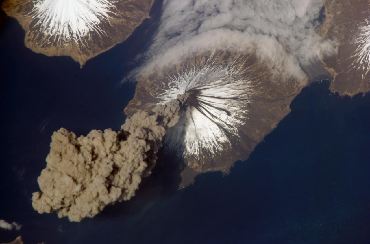 This May 23, 2006, photo released by NASA shows the eruption of Cleveland Volcano, Aleutian Islands, Alaska, as photographed by an Expedition 13 crew member on the International Space Station. The image captures the ash plume of the very short-lived eruption. (AP Photo/Courtesy of Earth Sciences and Image Analysis Laboratory, NASA Johnson Space Center)