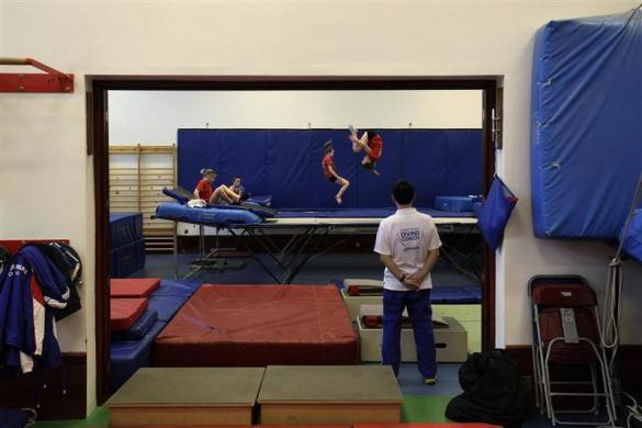 Crystal Palace diving club members practice on a trampoline during a training session in a dry diving gym in London March 9, 2012.