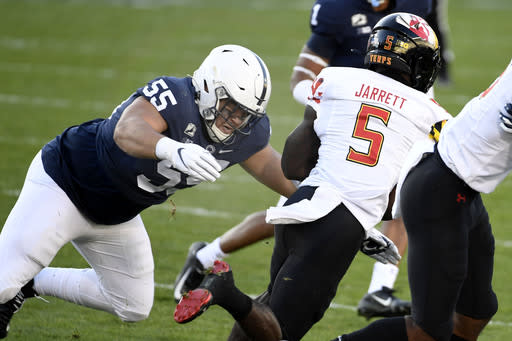 FILE - In this Saturday, Nov. 7, 2020 file photo, Penn State defensive tackle Antonio Shelton (55) tackles Maryland wide receiver Rakim Jarrett (5) in the first quarter of an NCAA college football game in State College, Pa. Florida is rebuilding its defensive line with help from the transfer portal. The Gators officially welcomed former Auburn defensive tackle Daquan Newkirk to the program Thursday, Jan. 14, 2021 a little more than a week after landing Penn State defensive tackle Antonio Shelton. (AP Photo/Barry Reeger, File)