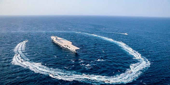 Iran strait of hormuz exercise on replica US aircraft carrier