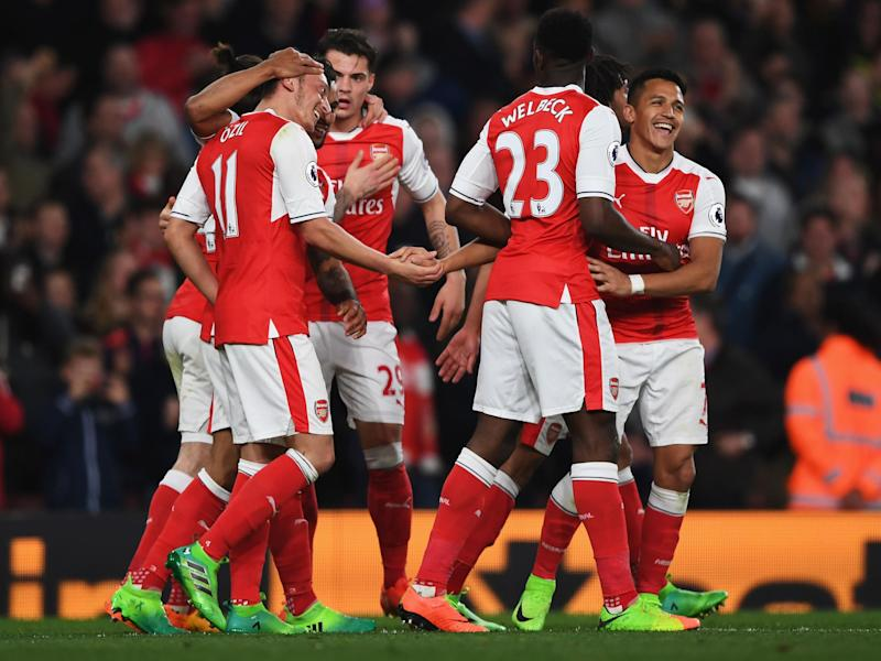 Arsenal's players celebrate Mesut Ozil's opening goal: Getty