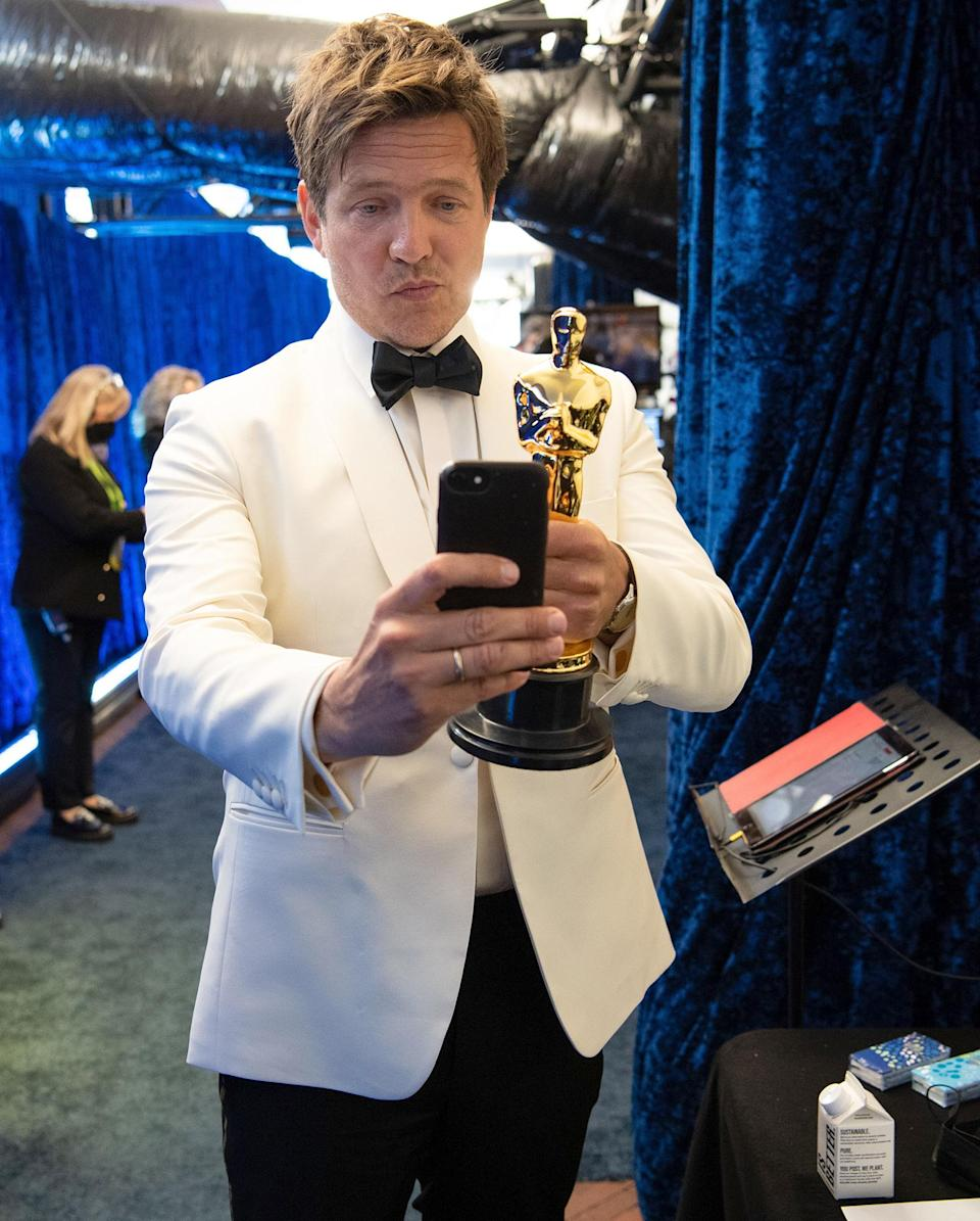 <p>Meanwhile, filmmaker Thomas Vinterberg snaps a selfie with his own Oscar for International Feature Film backstage at Union Station.</p>