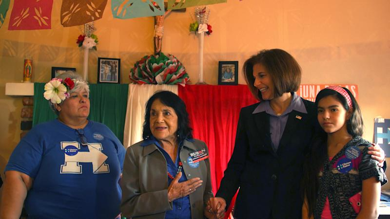 Guadalupe Arreola, civil rights activist Dolores Huerta, Nevada Democratic Senate candidate Catherine Cortez Masto, and an unidentified supporter address campaign volunteers in Arreola's Las Vegas home on Sept. 15, 2016. (Photo: Dalton Bennett/The Washington Post via Getty Images)