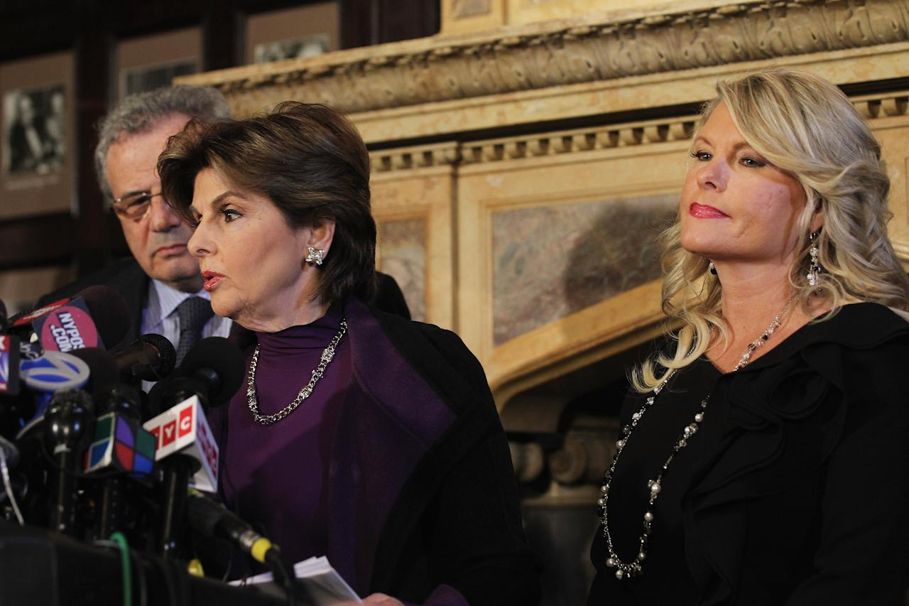 """NEW YORK, NY - NOVEMBER 07:  Sharon Bialek (R) listens as her attorney Gloria Allred speaks during a news conference to accuse Republican presidential candidate Herman Cain of sexual harassment more than a decade ago on November 7, 2011 in New York City. Bialek is the fourth woman to accuse Cain of inappropriate behavior when he was while CEO of the National Restaurant Association. She stated she is speaking out because she wanted to give """"a face and a voice"""" to support the other accusers who have remained anonymous.  (Photo by Spencer Platt/Getty Images)"""