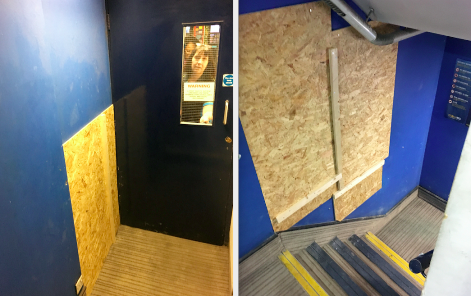 <em>Two gaping holes have been boarded up at a William Hill shop next to the Fleet Street jewellery shop (SWNS)</em>