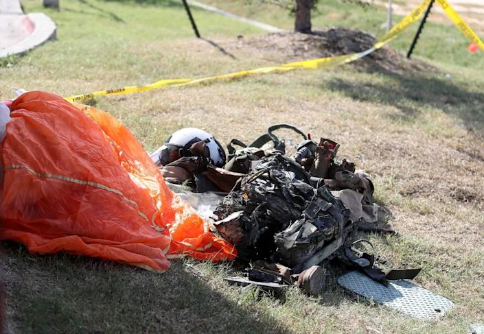 A parachute and gear from a Navy pilot who ejected before his military training jet crashed sits outside of Ole Donut on Sunday, September 19, 2021. Two Navy pilots who were on a training flight ejected from the plane and were taken to local hospitals with serious injuries, authorities said.