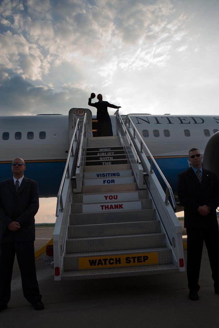 Vice President Joe Biden throws a football from the top of the stairs before boarding Air Force Two at Pittsburgh International Airport in Pittsburgh, PA, July 1,2009.