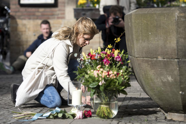 <p>A woman lays down flowers in front of the restaurant Kiepenkerl in Muenster, western Germany, Sunday, April 8, 2018, one day after a van crashed into people drinking outside the popular bar, killing two people and injuring others before the driver of the vehicle shot and killed himself inside it. (Photo: Marcel Kusch/dpa via AP) </p>