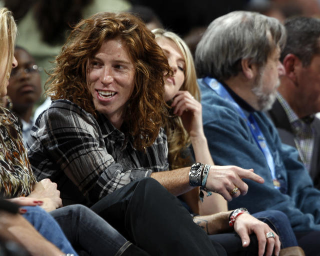 "<p>Professional snowboader Shaun White, known as ""The Flying Tomato,"" sits in a courtside seat to watch the Golden State Warriors face the Denver Nuggets in the first quarter of an NBA basketball game in Denver on Tuesday, Dec. 1, 2009. (AP Photo/David Zalubowski) </p>"