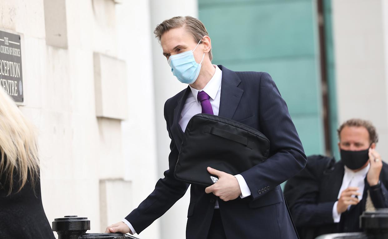 Television presenter Dr Christian Jessen arrives at Belfast High Court to give evidence in defamation proceedings taken against him by First Minister Arlene Foster. Picture date: Friday April 23, 2021.